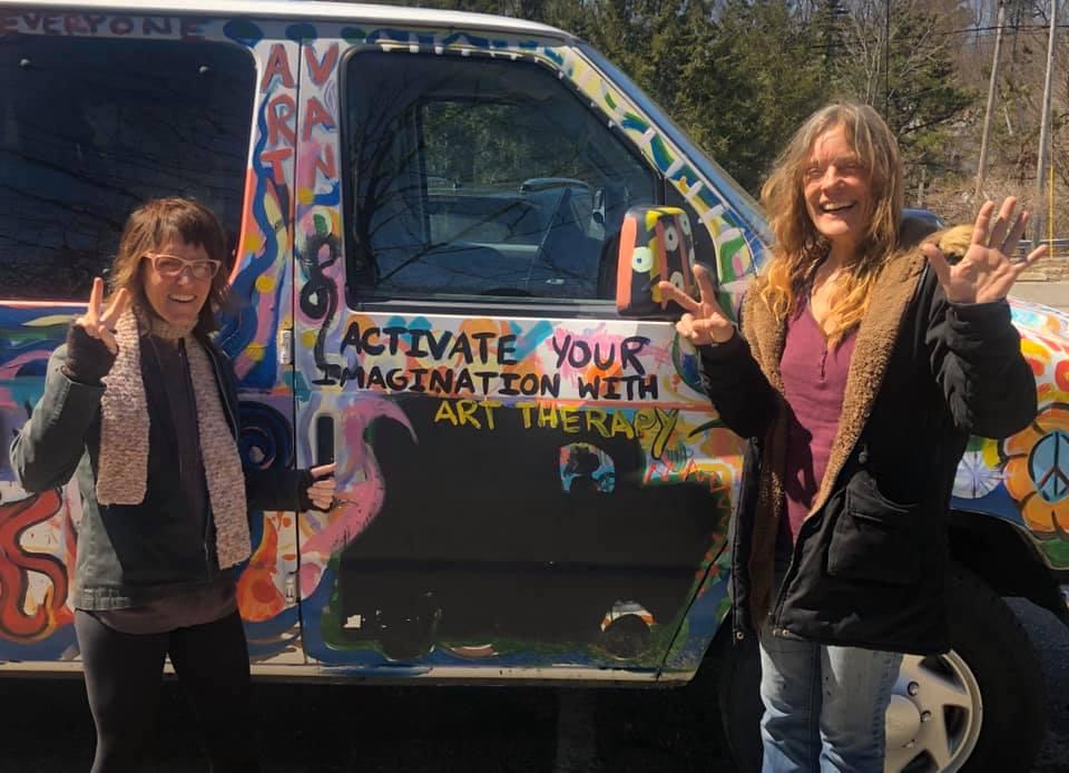 kelly & Jamie pose with the Van
