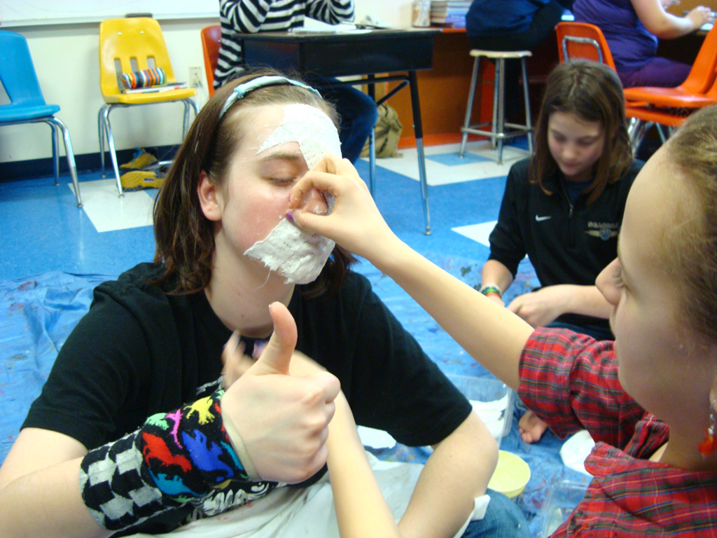 photo of AVAX student doing a body cast with plaster of paris